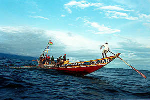 Local fishermen fishing from traditional canoes, in Sierra Leone waters. © Kate Davison