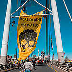 Action at Mandela Bridge in South Africa. © Shayne Robinson / Greenpeace