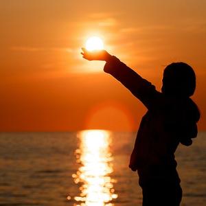 Child holding sun