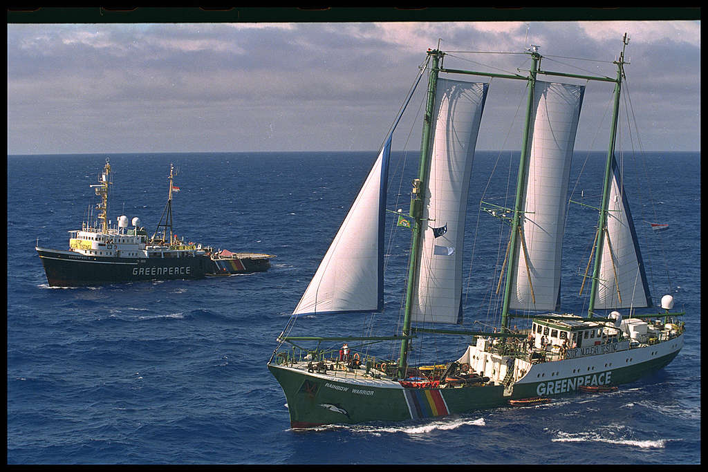 Greenpeace vessels SV Rainbow Warrior and MV Greenpeace outside the exclusion zone around Moruroa to protest against French Nuclear Testing at the atoll.