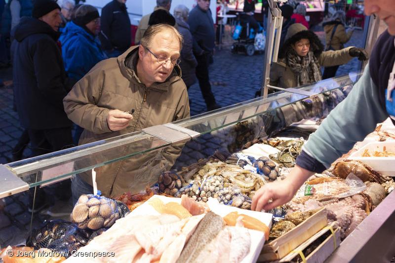 man buying seafood