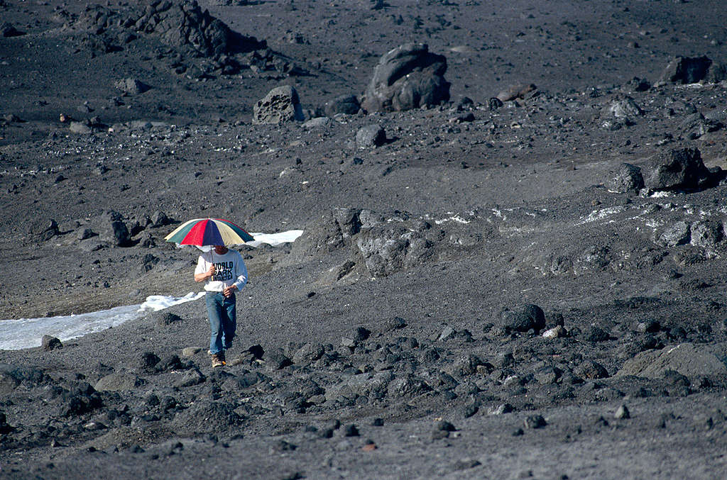 Marc Defourneaux holding Umbrella. © Greenpeace / Timothy A. Baker