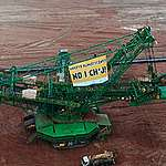 """""""Climate crisis? F*ck it!"""" – Greenpeace activists protest in the Turow coal mine"""