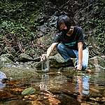 Greenpeace collected water samples for testing the quantity of microplastics in the countryside streams of Hong Kong. © Greenpeace / Chilam Wong