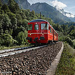 One adaptation measure to compact climate change is re-coloring black surfaces to white surfaces. As black surfaces absorb most of the light and therefore the heat, the white surface reflects the light and therefore capture less heat. In Austria in it's been first tested to paint railroads white to adapt to climate change.