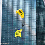 Paragliding activists land on ECB to expose support for fossil fuels