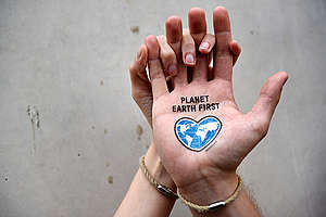"G20 Tattoo ""Planet Earth First"" in Hamburg. © Sandra Hoyn / Greenpeace"