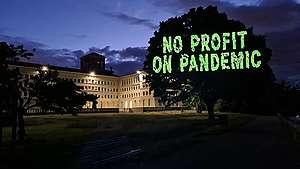 Vaccine Projection at WTO in Geneva. © Maxime Sauvant / Greenpeace