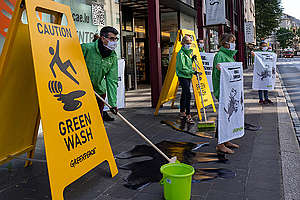 Greenwashing Action at National Pension Fund Headquarters in Luxembourg. © Sara Poza Alvarez / Greenpeace