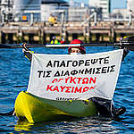 Greenpeace NL Blocks Oil Terminal and Launches Bid to Ban Fossil Fuel Ads in Europe. © Marten  van Dijl / Greenpeace