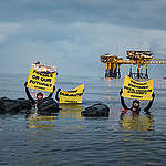 Project North Sea: Activists Swim to Oil Rig in Denmark. © Andrew McConnell / Greenpeace