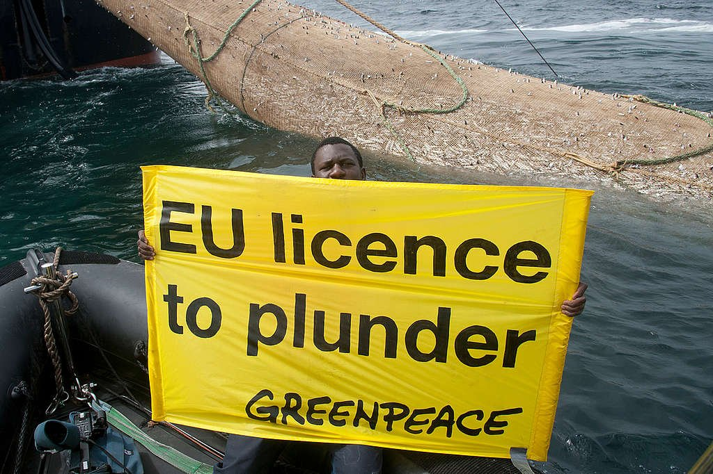 Protest against Overfishing in Africa. © Greenpeace / Pierre Gleizes