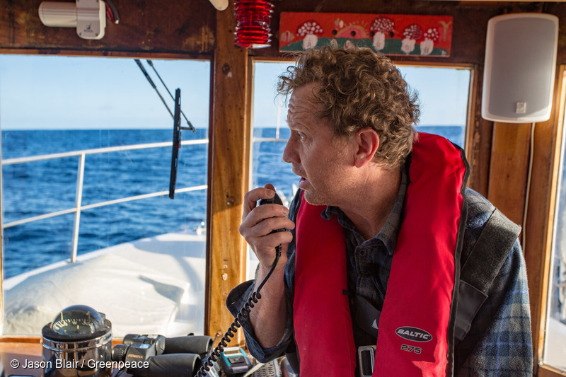 Greenpeace NZ Executive Director Russel Norman delivers radio message to seismic testing vessel the Amazon Warrior.
