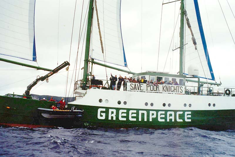 7 June 1996: Greenpeace's flagship SV Rainbow Warrior II sails from Whangarei to the Poor Knights Islands campaign for a ban on all fishing around the Poor Knights Islands, seen here with a 'Save Poor Knights' banner. Photo by Michael Szabo.jpg