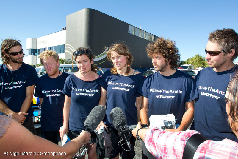 Actor Lucy Lawless, centre, and five Greenpeace activists, from left, Mike Buchanan, Raoni Hammer, Vivienne Hadlow, Shai Naides and Shayne Comino, outside New Plymouth's central police station, after their release on bail on charges relating to their 77-hour occupation of the Noble Discoverer.
