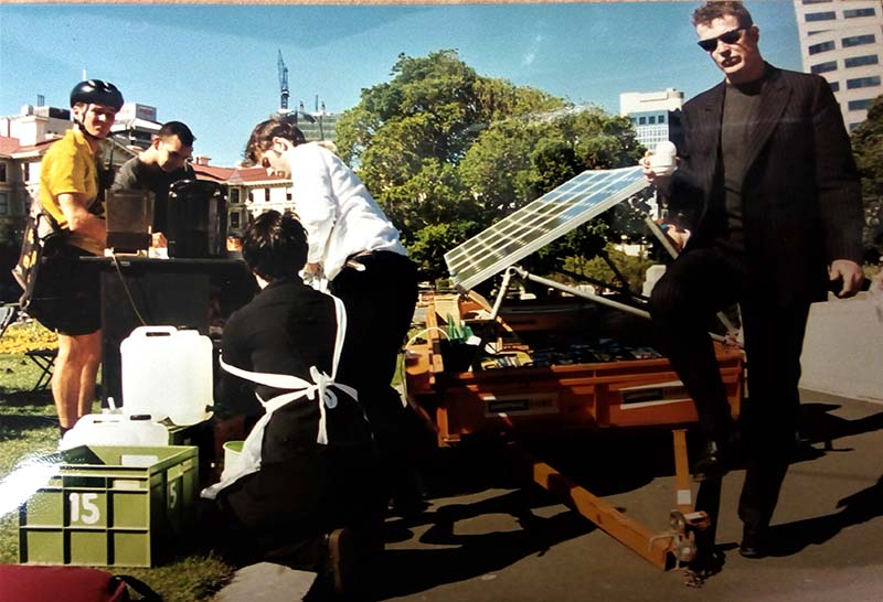 13 November 1997 Greenpeace Climate Campaigner Adam Laidlaw drinking a coffee from the Solar Café Greenpeace set up outside Parliament