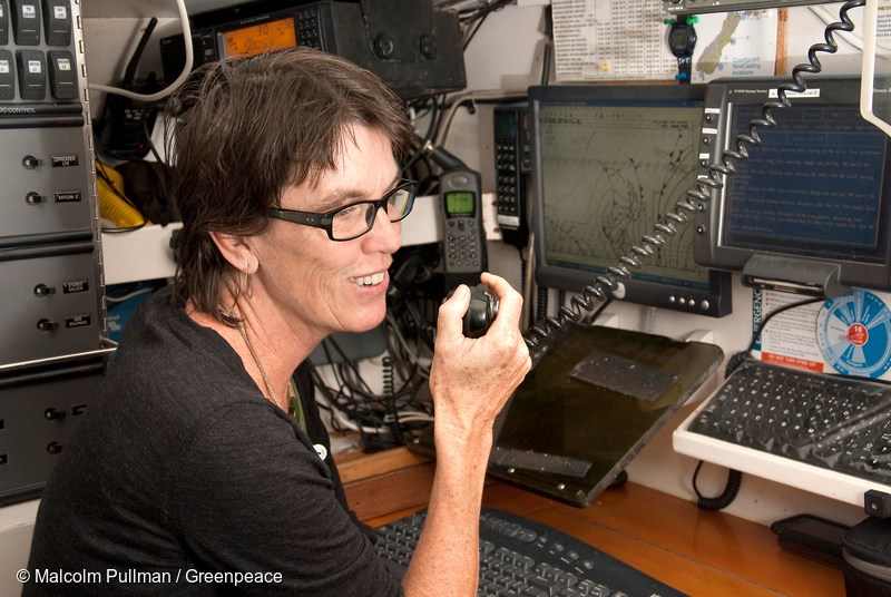 """Bunny McDiarmid, Executive Director of Greenpeace New Zealand and skipper of the """"Stop Deep Sea Oil"""" Flotilla vessel Tiama, at the yacht's navigation station off East Cape"""