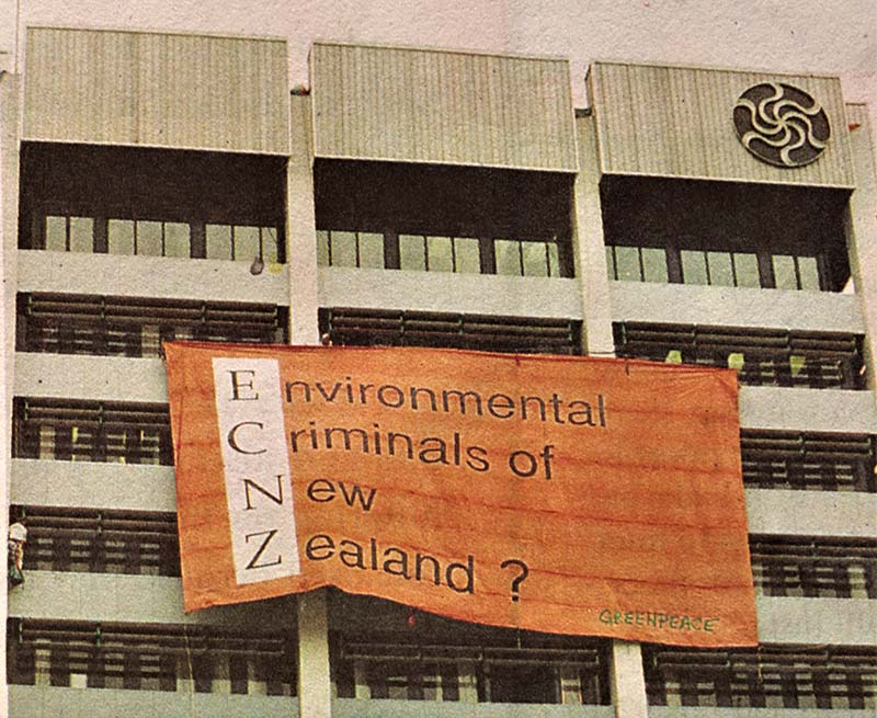 December 1993 Greenpeace activists hang a giant banner that reads 'Environmental Criminals of New Zealand E.C.N.Z.' at Electricorp's Wellington head office