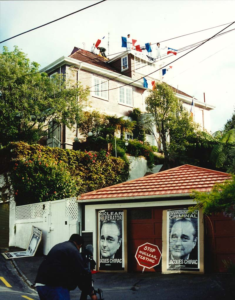 2 October 1995: Greenpeace activists protest against the second French nuclear test of the year by occupying the roof of the French Ambassador's residence in Wellington and delaying his departure for a meeting at the Beehive. Photo: Rob Taylor