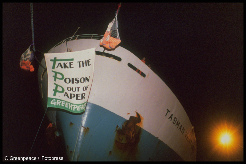 Greenpeace activists chained to ship TASMAN VENTURE against chlorine bleached pulp & paper it has aboard for Australian market