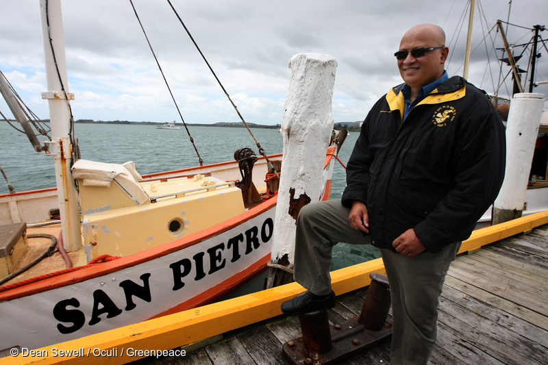 """Te Whanau a Apanui tribal leader Rikirangi Gage stands next to the tribe's fishing boat San Pietro in the Port of Tauranga. He spent some time aboard the vessel earlier in 2011 when it was part of the the """"Stop Deep Sea Oil"""" flotilla which disrupted seismic testing by Brazilian oil giant Petrobras in Raukumara Basin, off East Cape, North Island."""