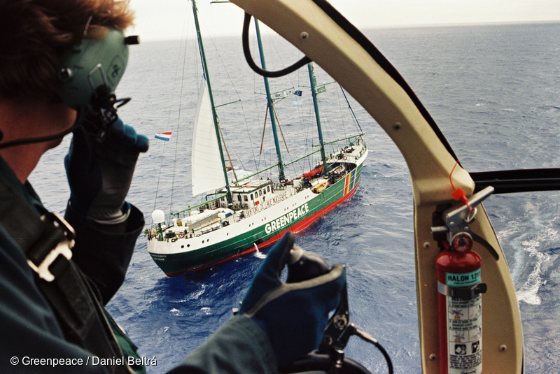 MV Greenpeace's helicopter flying over SV Rainbow Warrior II near the French Government's nuclear test site at Moruroa Atoll