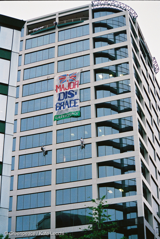The 'Major Disgrace' banner hangs from the AUT Tower opposite the Aotea Square venue of CHOGM