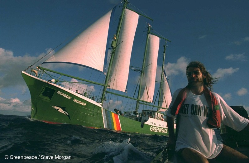 Crew member Alice Leney driving an inflatable boat, seen here flanked by SV Rainbow Warrior II, managed to reach the drill rig and lock himself to it