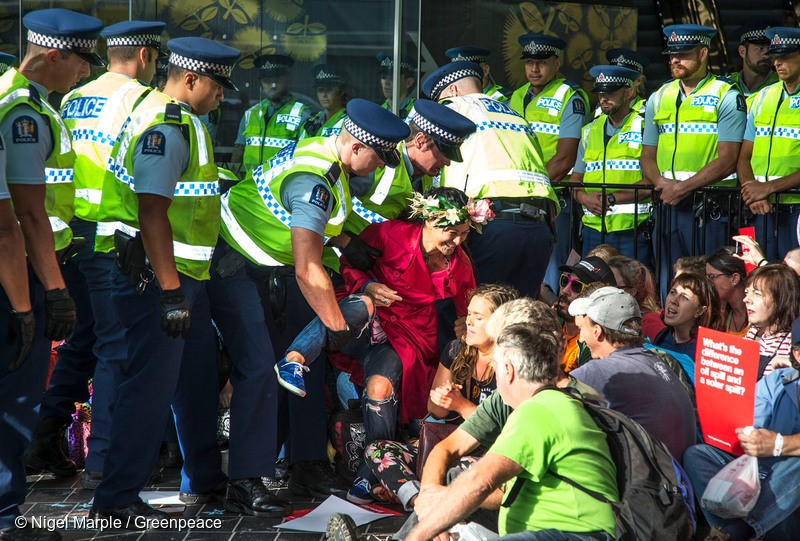More than 200 people descended on New Zealand's largest oil industry conference in Auckland and blocked its entrances as part of a Greenpeace-organised demonstration of peaceful civil disobedience. It's the first time in New Zealand that Greenpeace has invited the general public to take civil disobedience action en masse. Photo: Greenpeace/Nigel Marple