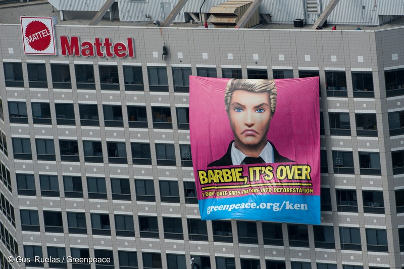 """Greenpeace activists dressed as """"Ken"""" dolls rappel down Mattell headquarters in Los Angeles, June 7, 2011, with a clear message to their former girlfriend: """"BARBIE: IT'S OVER. I DON'T DATE GIRLS THAT ARE INTO DEFORESTATION"""". Greenpeace investigators found that toymaker Mattel are using packaging from Asia Pulp and Paper (APP). APP has been exposed many times for wrecking Indonesia's rainforests to make products such as packaging."""