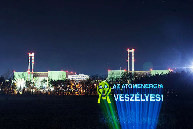 Projection on Trees in front of the Nuclear Power Plant in Hungary. © Bence Jardany
