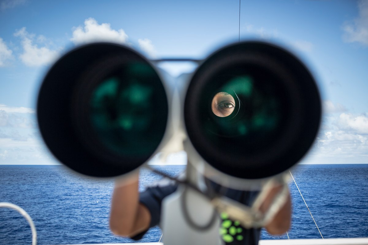 Crew member on the lookout for FADs © Will Rose / Greenpeace
