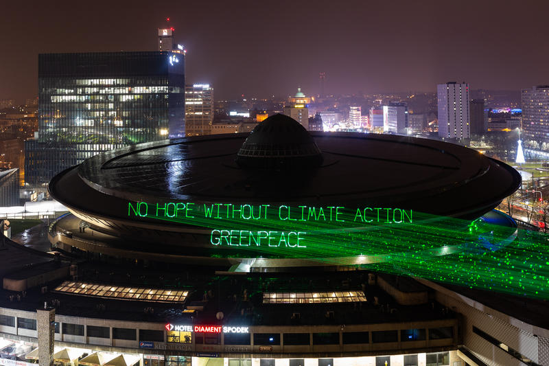 Laser projection on the COP24 venue in Poland urging the world leader to act on climate. © Konrad Konstantynowicz