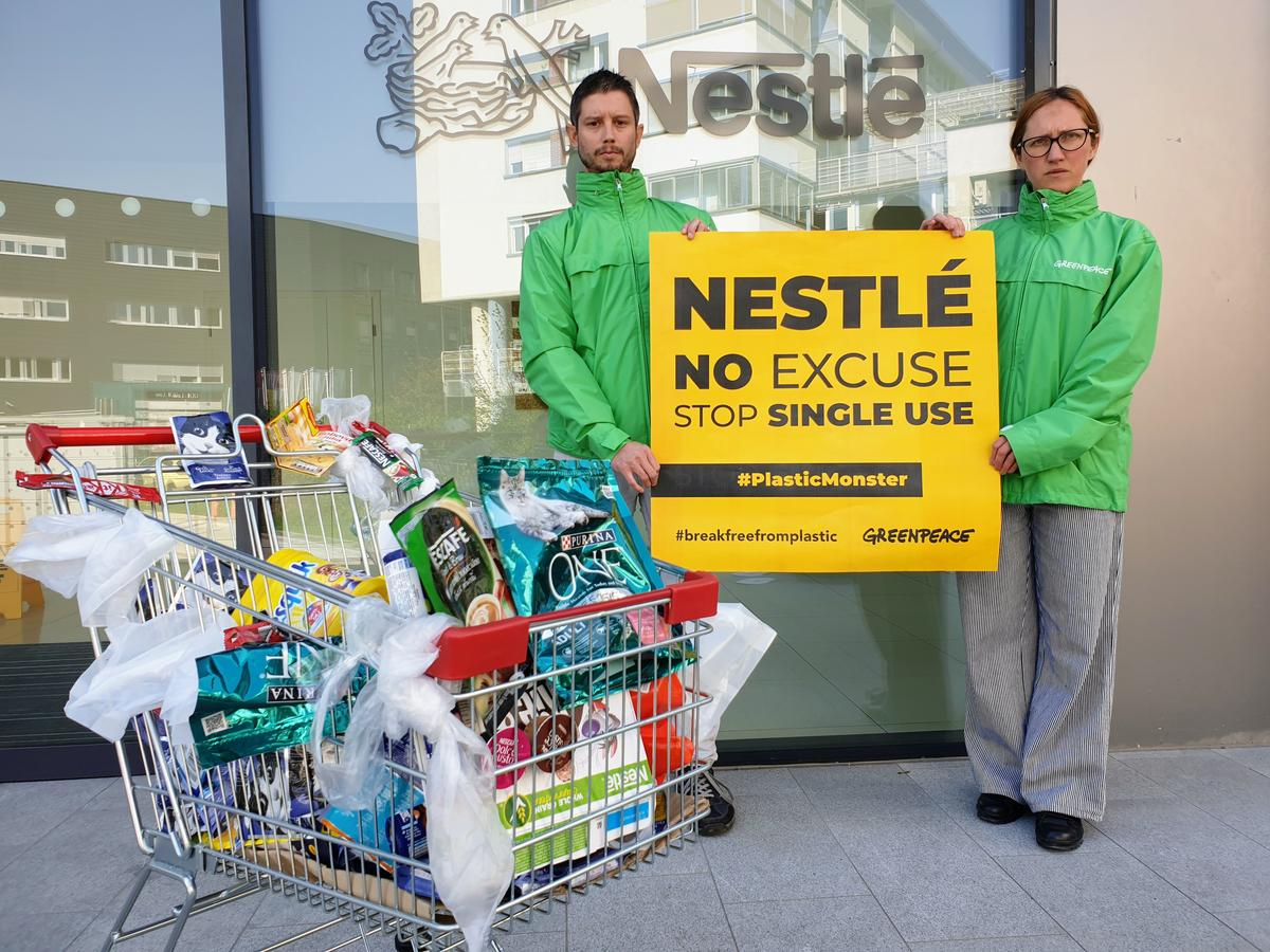 Plastic Monster Action at Nestlé Office in Slovenia. © Katja Hus / Greenpeace