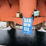 """In a peaceful protest Greenpeace activists from Norway, Sweden, Denmark and Germany climb the oil rig West Hercules, located near Rypefjord village in the north of Norway, and display a banner reading """"Ban New Oil"""". While a growing movement calling for real action on climate change is happening all over the world, Equinor's rig is preparing for a season of oil drilling in the Arctic waters of the Barents Sea. © Jani Sipilä / Greenpeace"""
