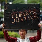 Activist Protest at Shell Headquarters in Manila. © Geric Cruz / Greenpeace