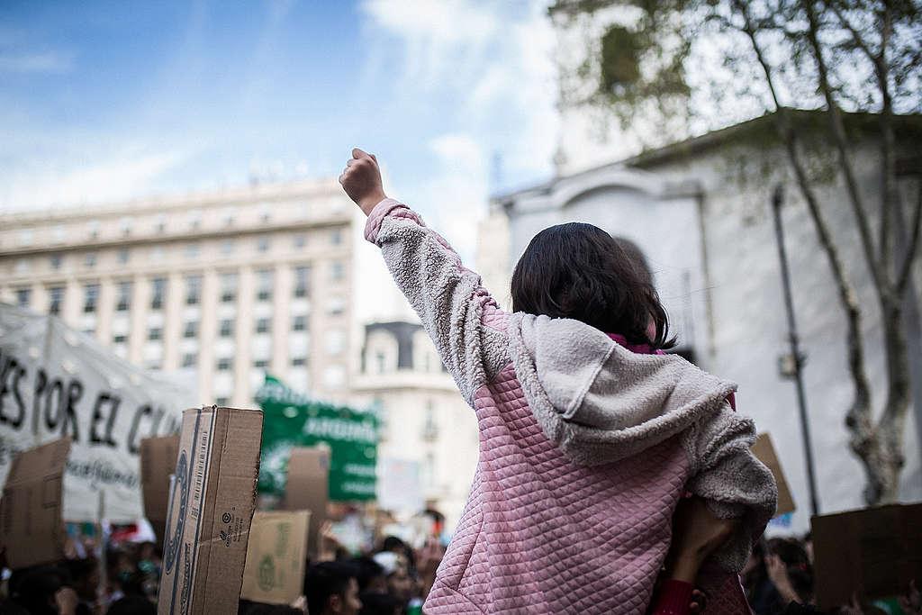 ©Nicolás Villalobos/Greenpeace  Young activist at a climate march in Buenos Aires, Argentina