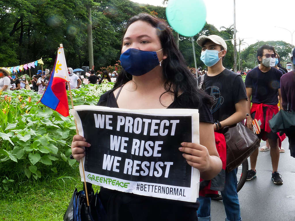 Greenpeace activists join the communities and civil society at the University of the Philippines, Quezon City in commemorating Independence Day in a peaceful solidarity activity to call on the government to scrap the proposed anti-terrorism bill.  © Greenpeace / Grace Duran-Cabus