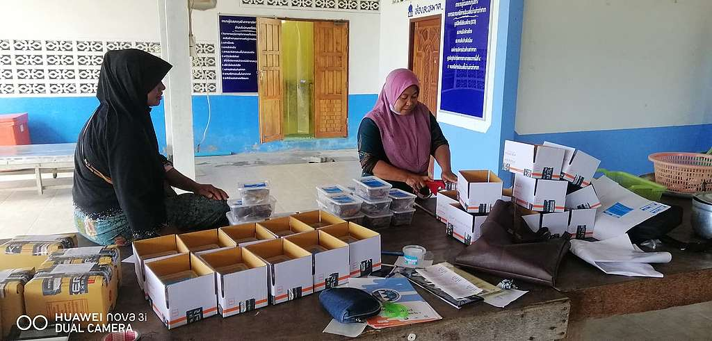 Seafood products getting packed for shipping to care workers