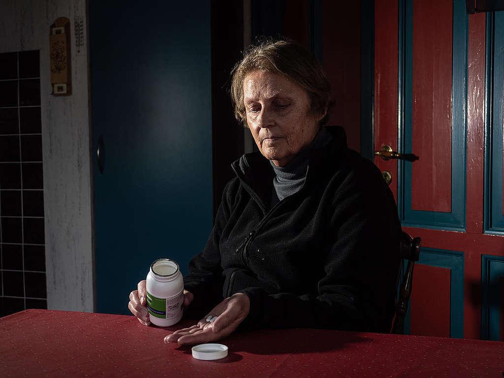 Woman Taking Medication in Home near Vandvaerksgaarden Factory Farm, Denmark. © Greenpeace / Wildlight / Selene Magnolia