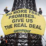 """On the occasion of the fifth anniversary of the adoption of the Paris Agreement, which is commemorated on Dec. 12th, Greenpeace Spain activists have scaled the replica of the Eiffel Tower in Torrejón de Ardoz (Madrid) on which they have placed a giant banner that reads """"Compliance with the Paris Agreement: as fake as this tower."""" The environmental organization is thus based on the symbol of Paris under which the historic climate agreement was adopted on December 12, 2015 and on a much smaller copy that is more in line with the deficit measures that the states are taking."""