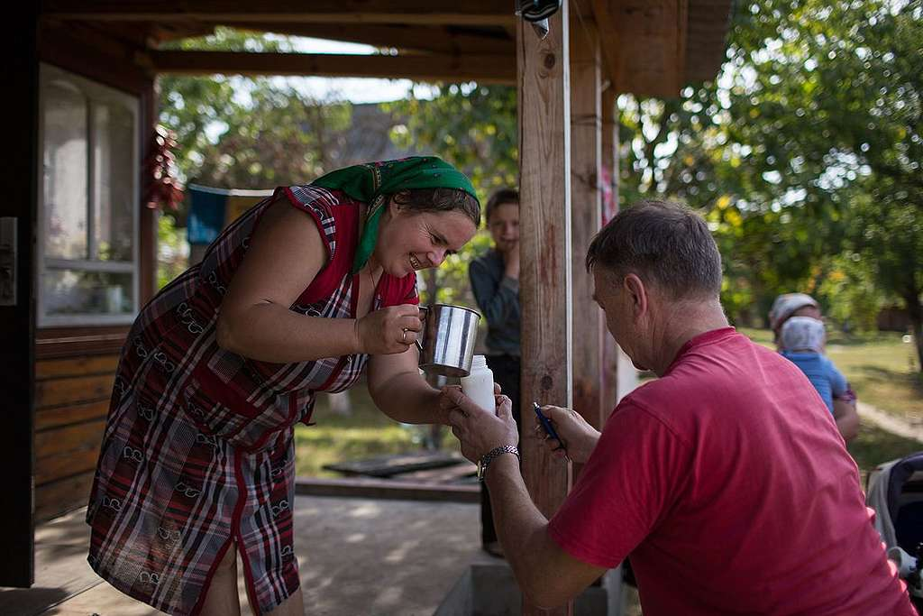 Taking Milk Samples in Ukraine. © Denis  Sinyakov / Greenpeace
