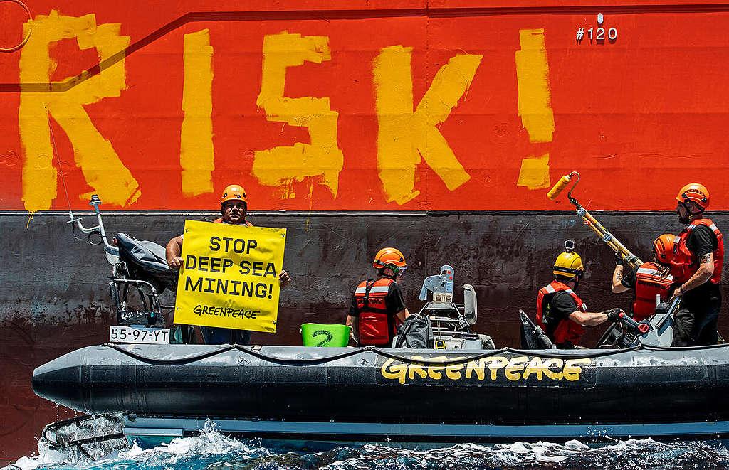 Activists Paint Deep Sea Mining Industry Vessel in the Pacific Ocean. © Marten  van Dijl / Greenpeace