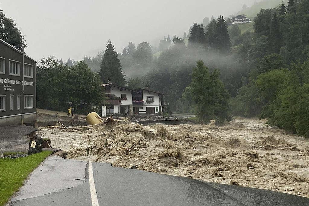 A damaged street is seen in Kelchsau near Kitzbuehel, Austria after heavy rainfall caused damaging floods and mudslides. © Zoom Tirol/AFP via Getty Images