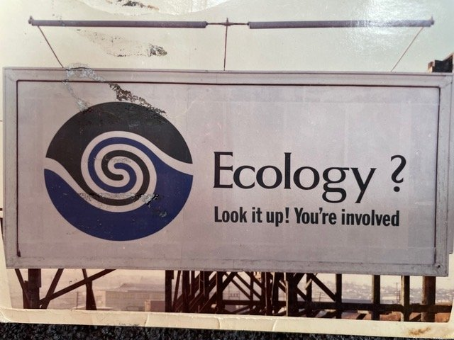 """Image of a billboard with message """"Ecology? Look it up! You're involved."""" These billboards were placed around Vancouver in 1970."""