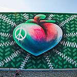 Swiss Street Art duo QueenKong paints above the roofs of Zurich.© Emanuel Büchler / QueenKong / Greenpeace