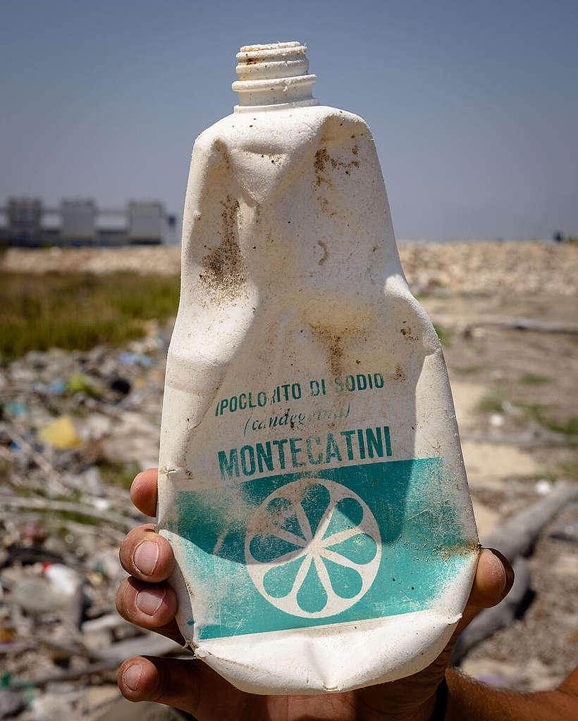 Montecatini bleach bottle on the beach in Brindisi, Italy