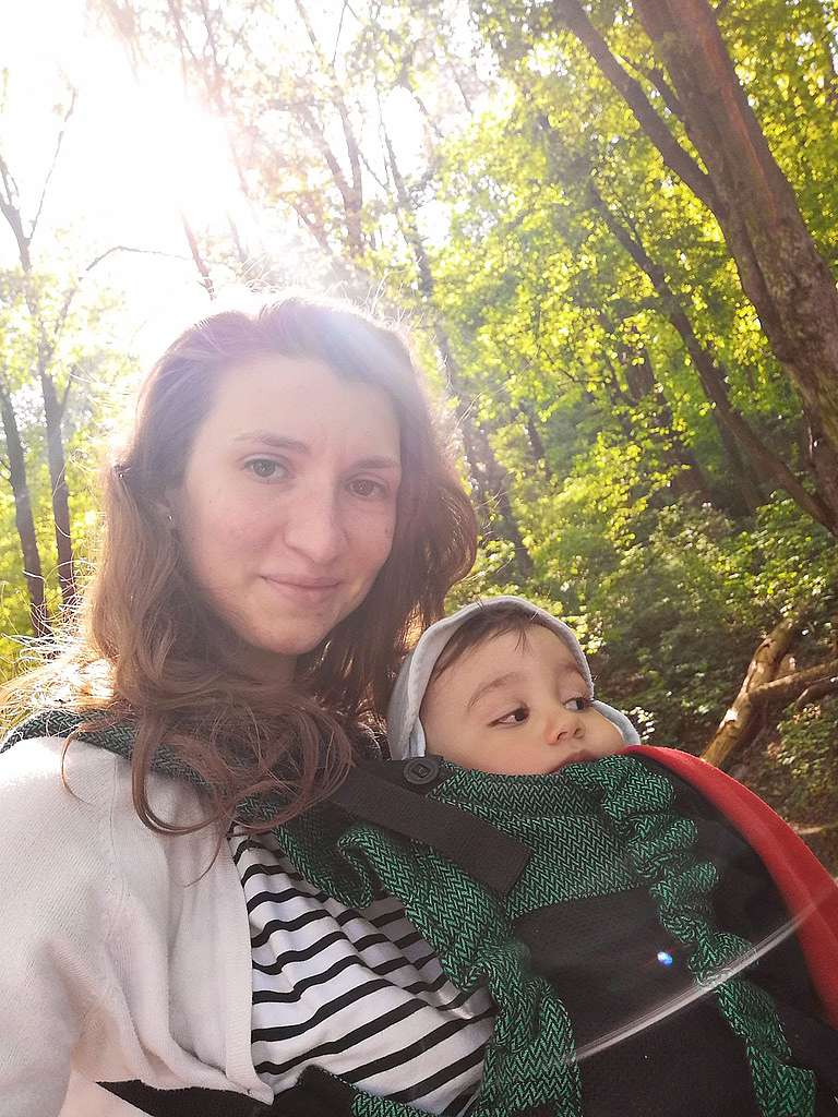 Antonia Macsim with her child in Brașov, Romania. As part of the #MobilityForAll campaign, Antonia shares their story of city life.