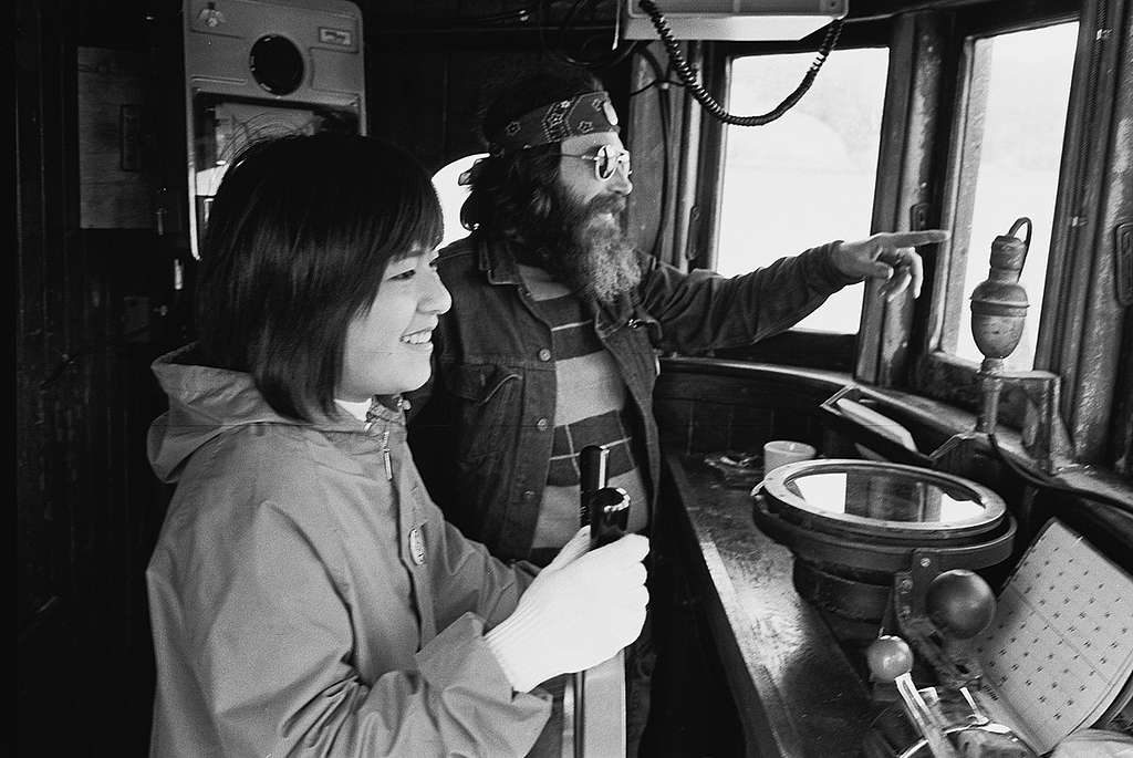 Taeko Miwa and Melville Gregory in the wheelhouse of the Phyllis Cormack, the first Greenpeace ship, 1975. © Greenpeace / Rex Weyler