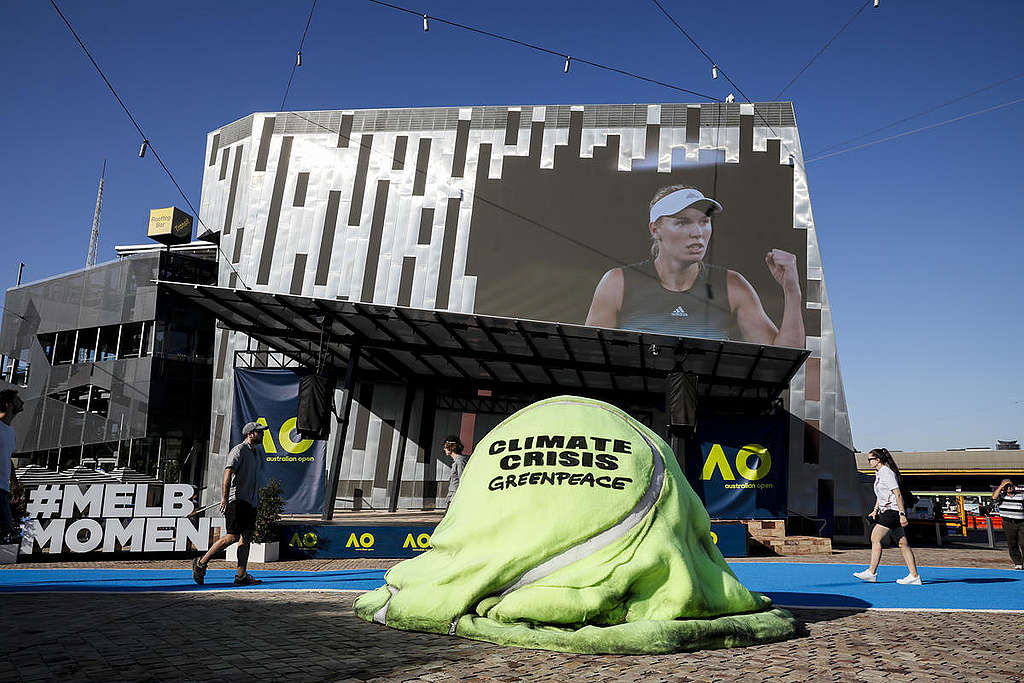 Melting Tennis Ball Climate Action in Melbourne. © Greenpeace